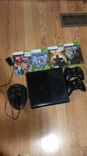 Xbox 360 and with 4 games plus with a charger with two controllers for Sale in Manassas, VA