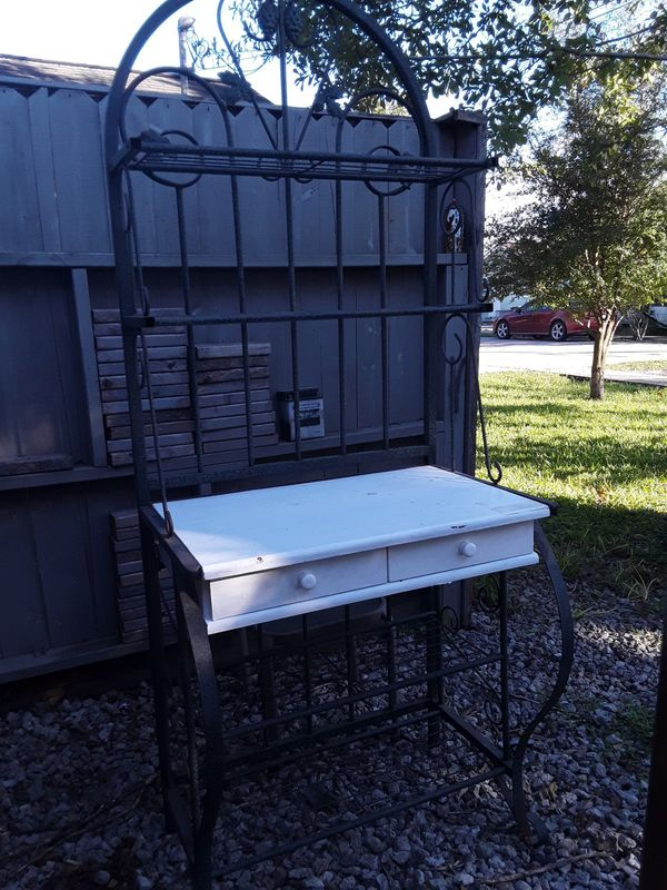 Selling a nice hardwood with iron white baker's rack great condition asking $90 deliver
