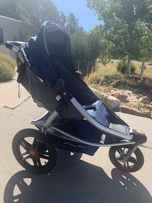 Burley Solstice stroller with child car seat carrier. for Sale in Santa Fe, NM