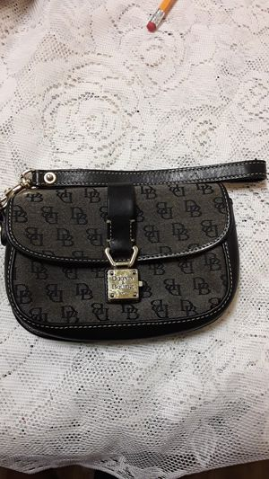 Dooney &bourke black 6x4wristlet. for Sale in Baltimore, MD