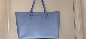 Michael Kors Traditional Tote with a matching wallet. Small stain left bottomed of tote. for Sale in Vallejo, CA
