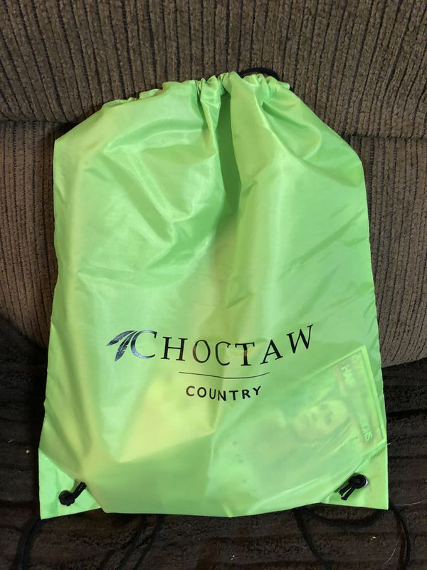 Small Polyester green backpack with goodies