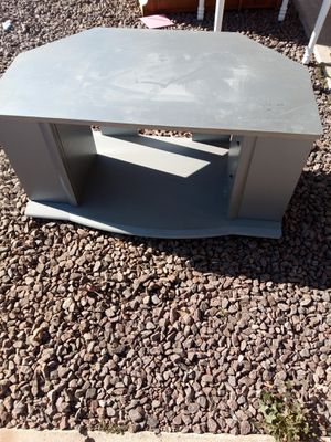 GRAY TV STAND WITH TWO DOORS THAT OPEN GOOD CONDITION DON'T HAVE SPACE $40 WILL HAVE CLEAN AND SANITIZED READY FOR PICKUP for Sale in Phoenix, AZ
