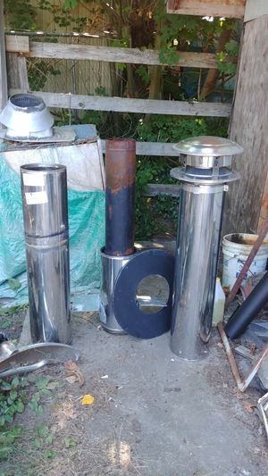 Earth wood stove with 6 in Insulated piping. Will heat up to 1,200 sq. Ft. for Sale in University Place, WA