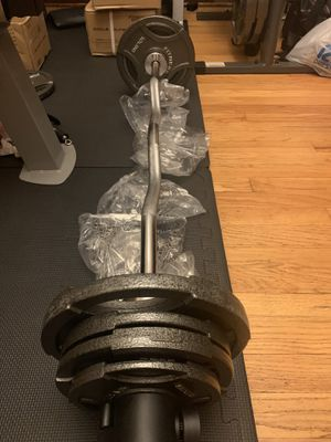 NEW OLYMPIC CURL BAR SET 60 LBS for Sale in Chicago, IL