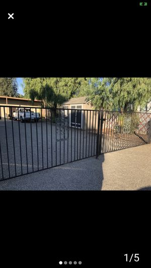 Iron driveway Gates plus side panels and walkthru gate for Sale in Norco, CA