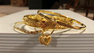 Gold Bangles with Edged Detailed CHarms for Sale in Baltimore, MD