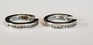 Stunning 10K white gold diamond pierced earrings for Sale in Lake Stevens, WA