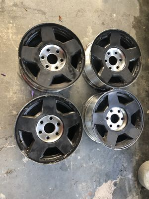 Four stock 17 inch spray painted black rims for Sale in Eloise, FL