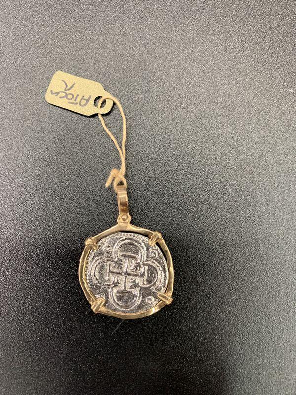 Atocha silver coin pendant in gold bezel