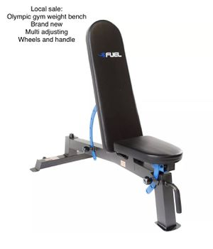 Olympic multi adjusting weight bench with handle and wheels brand new in box. The seat and back adjust and the bench is a FID bench so it adjusts fl for Sale in Edgewood, WA