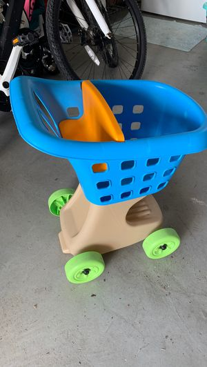 Step 2 blue and orange kids shopping cart toy for Sale in Apopka, FL