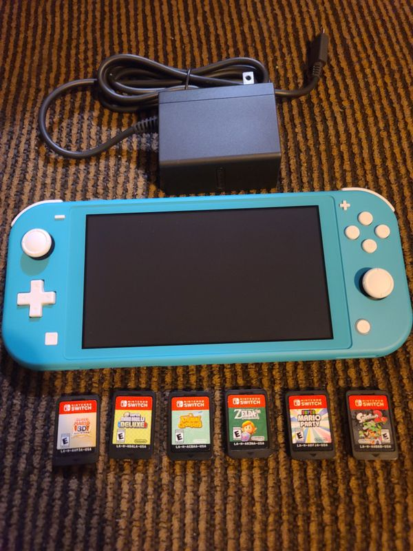 Nintendo switch lite new never used.....6 new games....$$320...(no cases)only pick up...