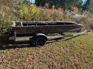 """Boat 🚣♀️ with trailer for sale size 15 feet tall 6 """" half aluminum must pick up in Kennesaw off wade green road please serious buyers only for Sale in Kennesaw, GA"""