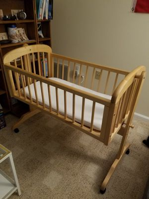 Solid wood bassinet + mattress + mesh for Sale in Ashburn, VA