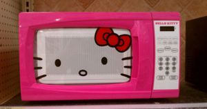 Pretty in pink with an adorable Hello Kitty design, 0.7 cubic foot/700 watt microwave . New for Sale in Henderson, NV