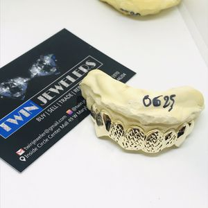 10Kt Gold grillz with diamond cut and fangs available on special offer for Sale in Indianapolis, IN