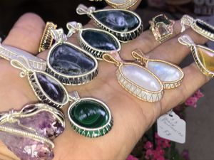 Crystal wire wrap pendants - moonstone - malachite- tiger eye for Sale in Clearwater, FL