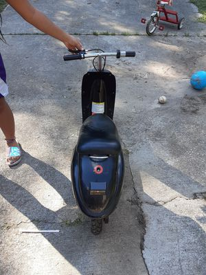 Mini scooter for a kid. Front tire needs to be plugged but runs good. My kid doesn't ride it anymore so it's just setting in the garage for Sale in Stonecrest, GA
