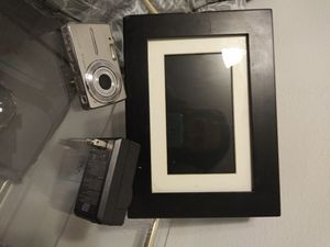 Digital camera and frame includes charger for Sale in Rancho Cordova, CA