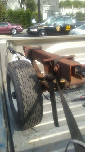 This is a trailer axle with lease springs and shackles and wheels and tires for Sale in Los Angeles, CA
