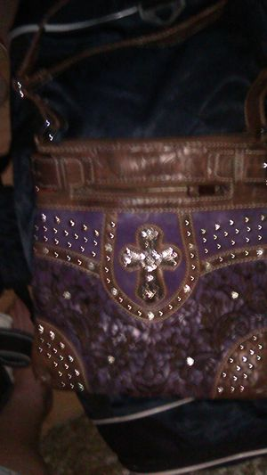Purple purse with cross on it for Sale in Las Vegas, NV
