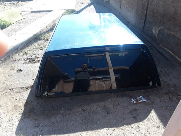 Camper shell for a Chevy truck