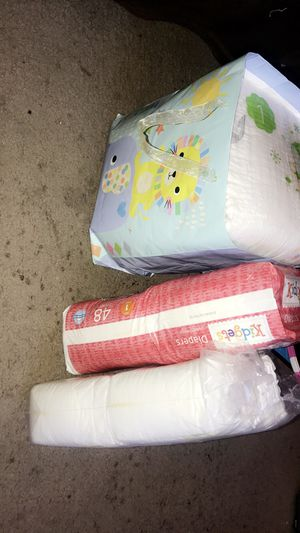 Newborn swaddlers , size 1 babyganics , and kidgets diapers for Sale in Houston, TX