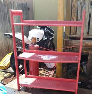 Red metal tool shelves for Sale in Odessa, TX
