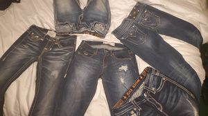 Miss me, rock revival, and Hollister girl jeans and a michael Kors purse pretty much brand new for Sale in Bakersfield, CA