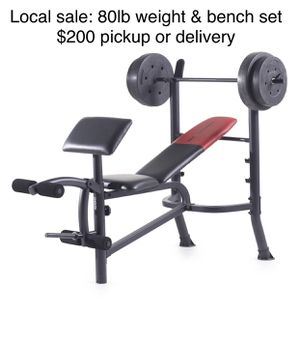 Brand new I'm box. Utility weight bench with rack , leg extension and preacher curl workout areas, also includes 80lbs of weight plates and a barbell for Sale in Puyallup, WA