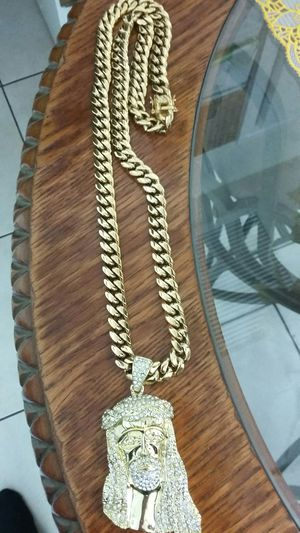 Very nice 14kt gold over stainless steel 12mm by 3oinch long Miami Cuban link Chain with nice jesus charm for sale !! for Sale in Tampa, FL