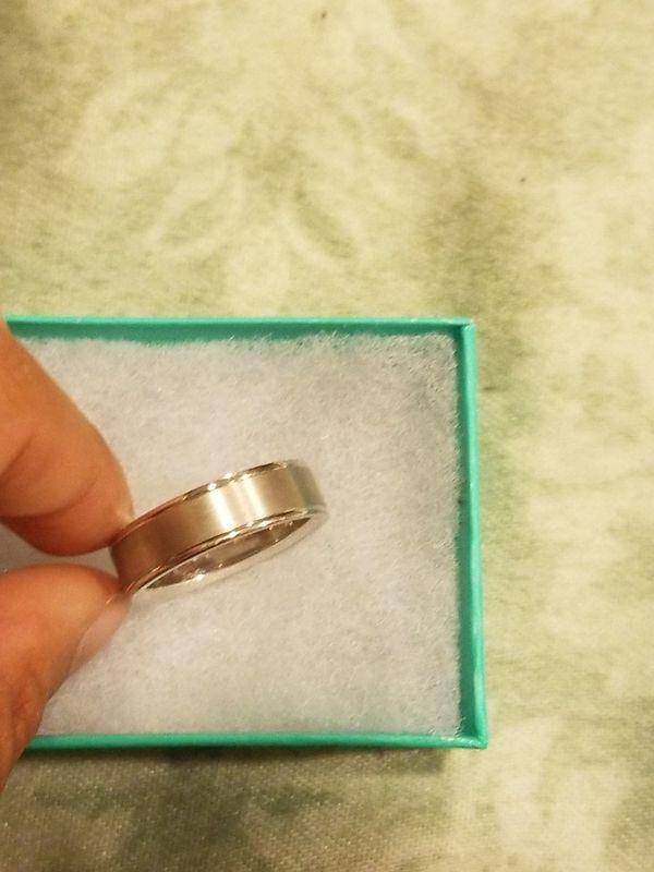 Brand new wedding ring still in box