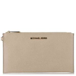 Michael Kors nude clutch for Sale in Miami, FL