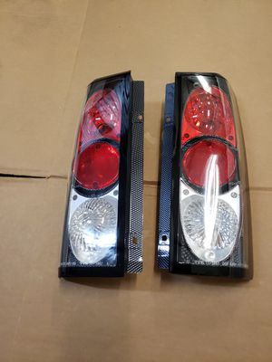 CHEVY ASTRO VAN 1985-2004 TAILLIGHTS CARBON FIBER IMITATION BRAND NEW ( ASTRO VAN OR GMC SAFARI PARTS for Sale in Hialeah, FL