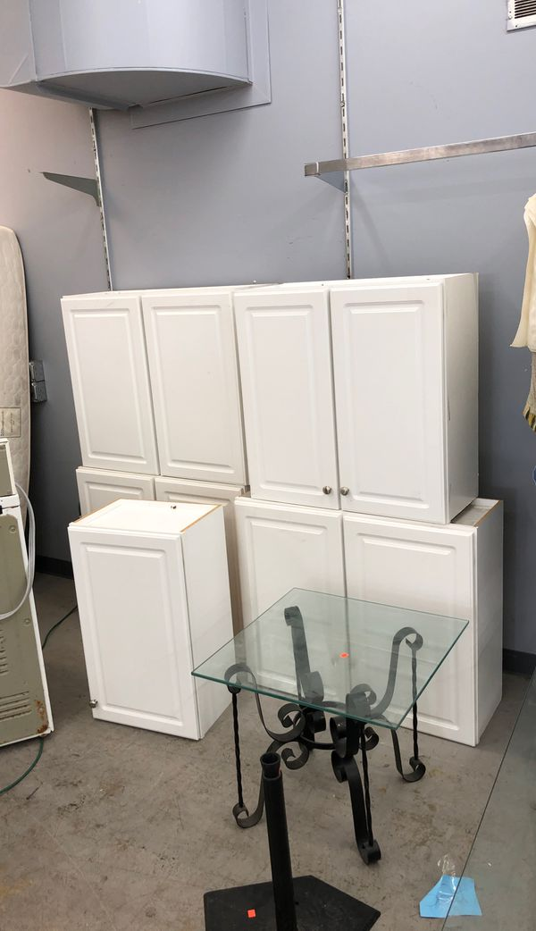 Five white upper cabinets
