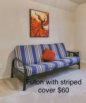 Futon with striped cover for Sale in Houston, TX