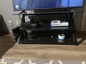 Glass black tv stand for Sale in Minneapolis, MN