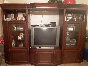 7 piece entertainment center with alot of storage also racks to hold cds in for Sale in Bonita Springs, FL