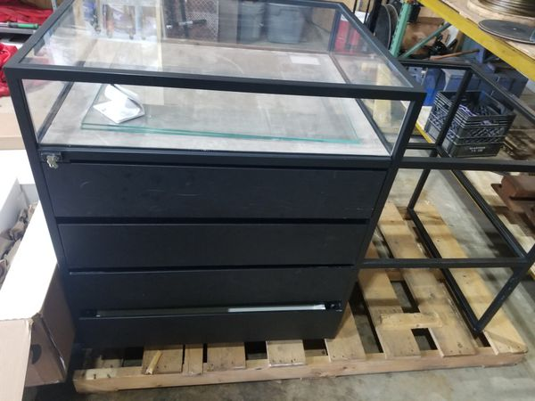Heavy duty metal and glass display with drawers and glass shelves