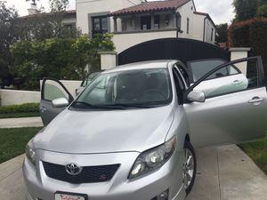 """CLEAN TITLE Toyota Corolla sport 93,000 millas 2010 muy buenas condiciones a toda prueva """"1 solo Dueño""""puede traer su Mecanico TITULO EN MANO for Sale in Los Angeles, CA"""
