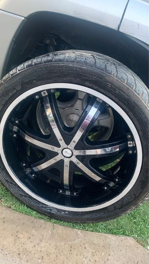 4 rims with tires , 3 times missing cap . Universal 6 slug . 22 inch for Sale in Bakersfield, CA