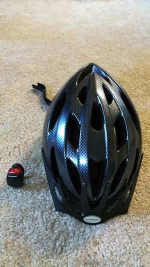 Helmet and tag light from SCHWINN for Sale in Rockville, MD