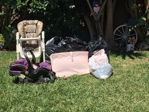 5 full trash bags full of Baby clothes, adult women's and men clothing, car seat, high chair, baby shoes and women shoes 100$ obo for Sale in Pico Rivera, CA