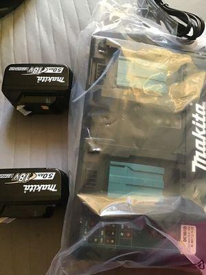 Son dos pilas y un cargador for Sale in Los Angeles, CA