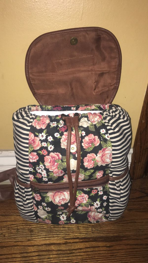 Pink floral backpack with stripes on side