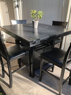 """Excellent condition high table with barstool dimensions Table top is 3'5""""... 3 foot tall Waist height... the chairs 2ft high With leather cushions for Sale in Solana Beach, CA"""