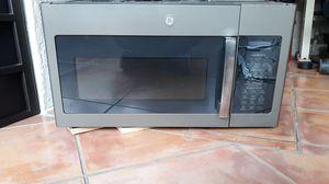 GE 1.7 cu ft Over The Range Microwave for Sale in Port Charlotte, FL