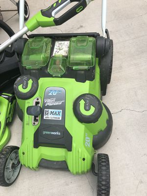 Greenworks electric 3 pieces.charger an 2 batteries. Cord less string trimer, lawn mower and blower. for Sale in Los Angeles, CA