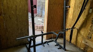 Squat rack w/ barbell and preacher curl bar for Sale in Tempe, AZ